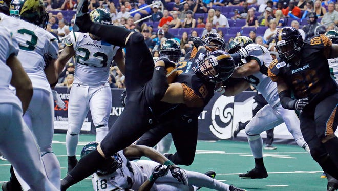 The Rattlers'  Michael Huey dives to the 1-yard line to set up a touchdown in the third quarter of their 72-56 win over the San Jose SaberCats in the National Conference final on Aug. 10, 2014.