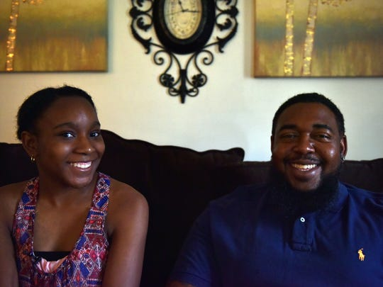 Single father Roderick Williams, right, of Jackson, is navigating life with 13-year-old daughter Diovian.
