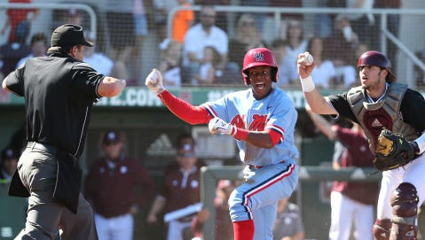 Ole Miss' Errol Robinson celebrates after beating the throw at home against Mississippi State last weekend. The Rebels are ranked seventh in the RPI after the win.