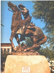A statue outside the Yavapai County Court House in