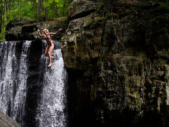 Shelby Roelke of Elkton, Md. jumps off a cliff into