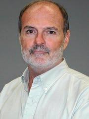 John Crisp is a TNS op-ed writer. (TNS)