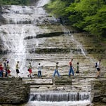 Visitors cross the bridge over Buttermilk Creek on a busy Saturday afternoon in 2009 at Buttermilk Falls State Park in Ithaca