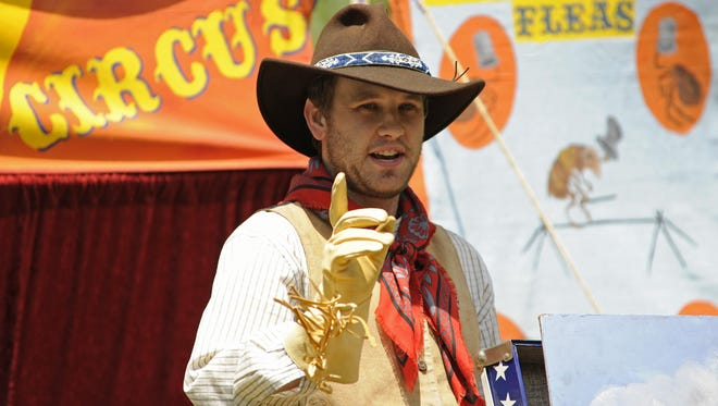 Matt Bastian of Cedar Grove entertains during a flea circus during a Buffalo Bill's Wild West event last year at Pinecrest Historical Village in Manitowoc.