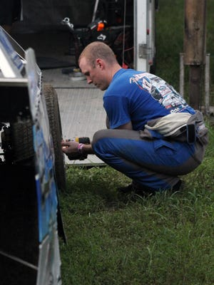 Dalton Krysa, a former star running back for Fort Osage who went on to play collegiately at Missouri Western, works on his new race car prior to a race at Valley Speedway in Grain Valley. Krysa, now a physical therapist, said he is feeding his competitive spirit with auto racing.