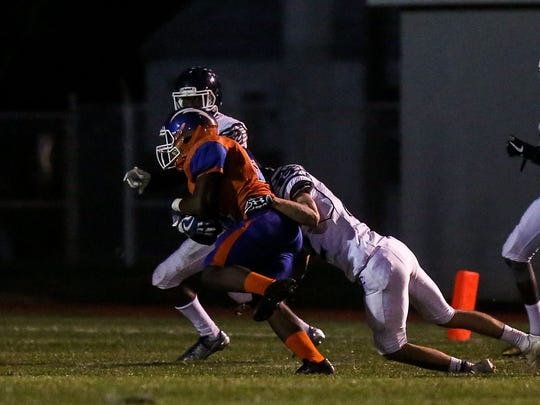 Millville's Dashon Byers returns a interception for a long gain against Atlantic City on Friday.