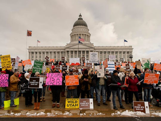 Protesters gather before a visit by President Donald
