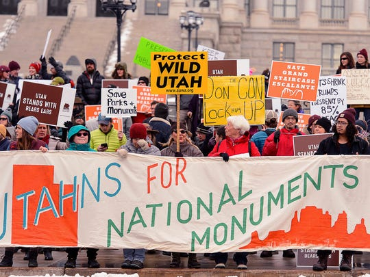 Protesters gather before a visit by President Donald Trump to announce that he is scaling back two sprawling national monuments, Monday Dec. 4, 2017, in Salt Lake City.