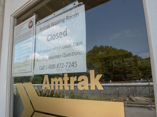 Signs for the Amtrak waiting room being closed are