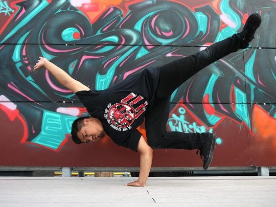 Des Moines breakdancer and instructor Anthony San performs