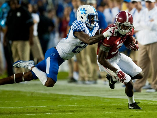 Kentucky defensive back Derrick Baity (29) wraps up Alabama wide receiver Calvin Ridley (3) at Bryant-Denny Stadium in Tuscaloosa, Ala., on Saturday October 1, 2016.