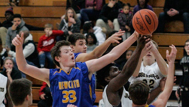 NewCath's Trey Wurtz and others battle for a rebound.