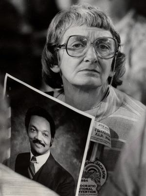 Anne Braden held a picture of the Rev. Jesse Jackson, whose presidential candidacy she supported, when she attended the Democratic National Convention in San, Francisco as an alternative delegate. July 19, 1984.