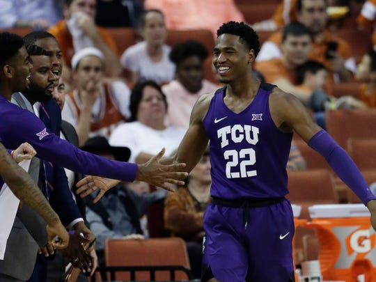 TCU guard RJ Nembhard (22) celebrates with teammates after scoring against Texas during the second half of an NCAA college basketball game, Saturday, March 9, 2019, in Austin, Texas. (AP Photo/Eric Gay)