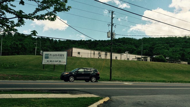Apartments are planned for the former Plasti-Form site at Mills Gap and Sweeten Creek Roads.