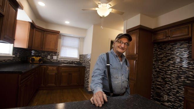 Contractor John Quidone shows off the kitchen he renovated in a house on Mullberry Street, Middletown.