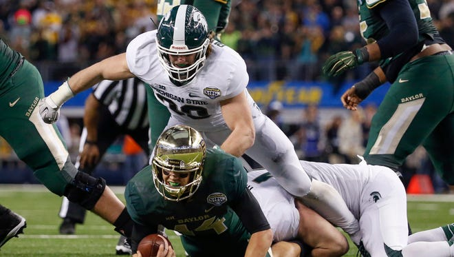 MSU's Riley Bullough sacks Baylor quarterback Bryce Petty at this year's Cotton Bowl. Bullough returns at middle linebacker for the Spartans.