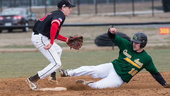 Bennett's Ryan Mitchell (25) attempts to tag a Queen Anne's baserunner on Monday, March 26, 2018.