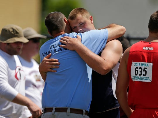 Bay Port's Cole Van Lanen gets a hug from his father, Tom, after winning the Division 1 shot put event during the WIAA state track and field meet at Veterans Memorial Field Sports Complex in La Crosse on June 3.