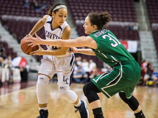 Lebanon Catholic's Jasmine Turner looks for a way past Juniata Valley's Halee Smith as Lebanon Catholic defeated Juniata Valley 55-43 in the PIAA Class 1A state championship on Friday, March 24, 2017 at the Giant Center. This is the third state championship for Lebanon Catholic in the school's history.