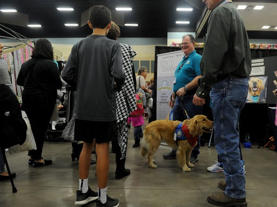 Elijah works as a comfort dog with the Lutheran Church Charities during the Sheppard Officers' Spouses' Club Hanger Holiday Saturday, Nov. 11, 2017, in the Ray Clymer Exhibit Hall at the MPEC.