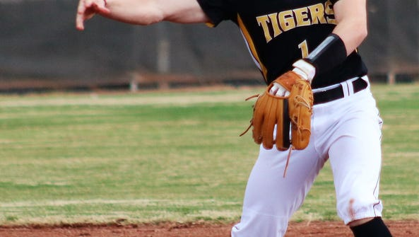 Alamogordo's Evan Best makes a throw over to first