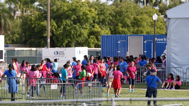 Immigrant children play outside a former Job Corps site that now houses them, Monday, June 18, 2018, in Homestead, Fla.