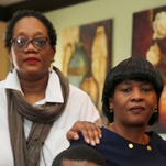Charles Sims, Jr., with his mother, Lana Turner-Sims, right, and Yvetta Collins, family mental health advocate at the Sims Forest Park home. The Sims family will be suing the Winton Woods City School District this week in federal court. The family allege the district deprived Charles Sims Jr., now 19, of educational needs and went so far as to ignore them. He suffers from a major depressive disorder, anxiety, ADHD. He has several learning disorders, migraines and non-epileptic staring spells.