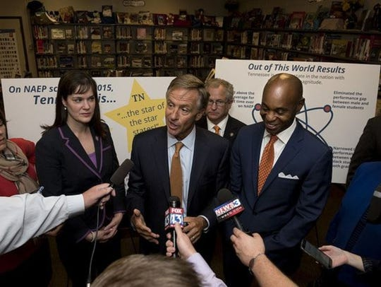 Education Commissioner Candice McQueen and Shelby County Schools Superintendent Dorsey Hopson flank Gov. Bill Haslam at a 2016 event in Memphis.
