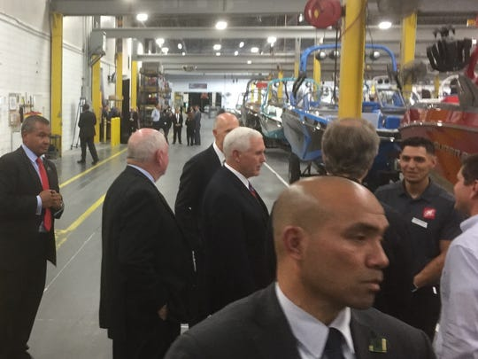 Vice President Mike Pence (center) tours the Correct