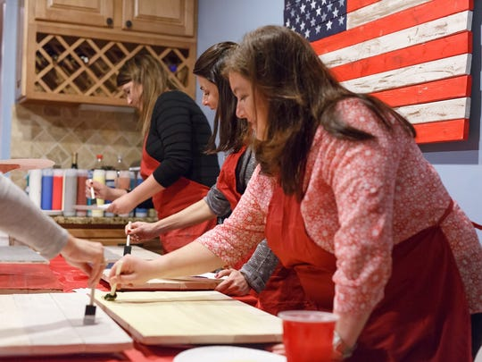 Pallet painting parties by Crimson Pallet. Photograph