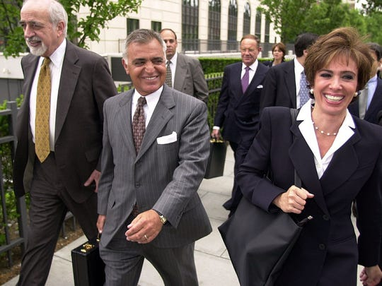 Albert Pirro of Harrison, centered, walks with his Attorney Gustave Newman, at left, and his wife, Westchester District Attorney Jeanine Pirro, at right, as they leave the Westchester Federal Court Building in White Plains on Wednesday. June 13, 2000