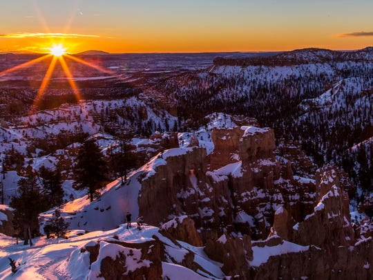 Photographers capture the sunrise at Bryce Canyon National Park.