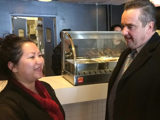 Mai Yang, of Houa's BBQ, talks with Green Bay Mayor