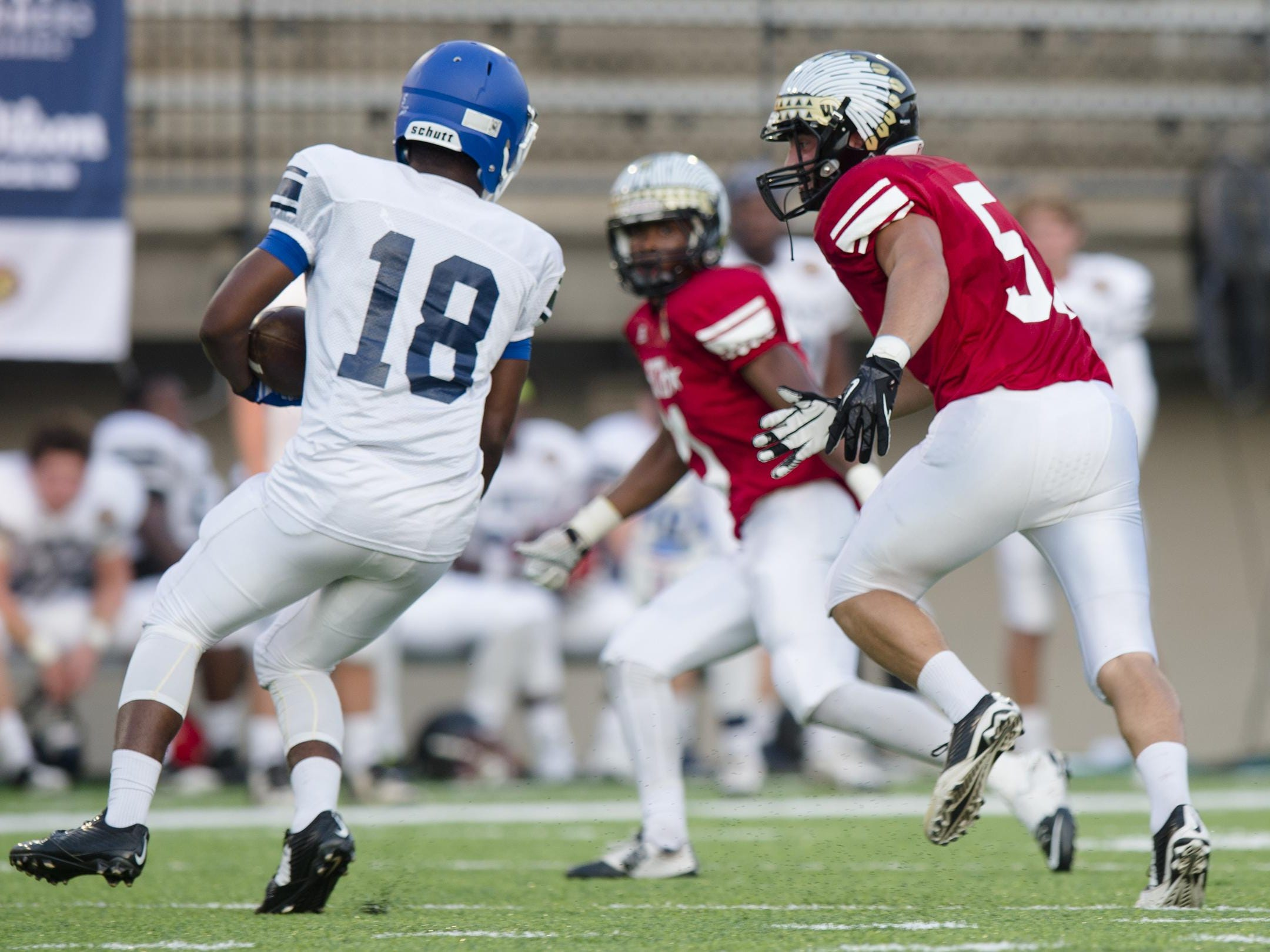South All-Star Cameron Compton of Wetumpka chases down North All-Star Eddie Williams of Tuscaloosa County during the AHSAA North vs. South All Star game on Friday, July 17, 2015, in Montgomery, Ala.