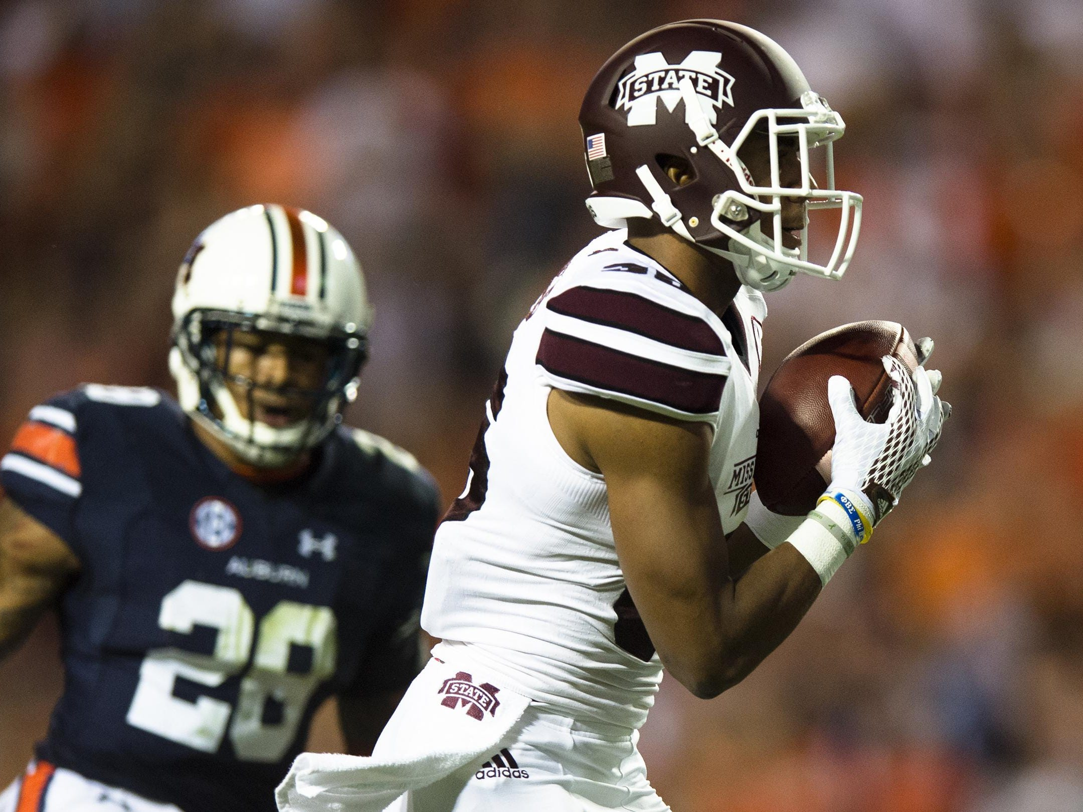 Mississippi State wide receiver Gabe Myles (35) catches a touchdown pass as Auburn defensive back Tray Matthews (28) looks on during the NCAA football game between Auburn and Mississippi State on Saturday, Sept. 26, 2015, at Jordan-Hare Stadium in Auburn, Ala. Albert Cesare / Advertiser
