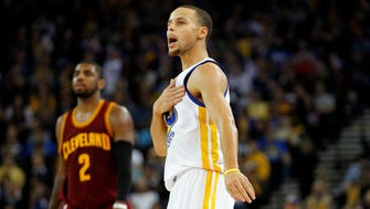 Warriors guard Stephen Curry pounds his chest during a Jan. 9 victory vs. the Cavs.