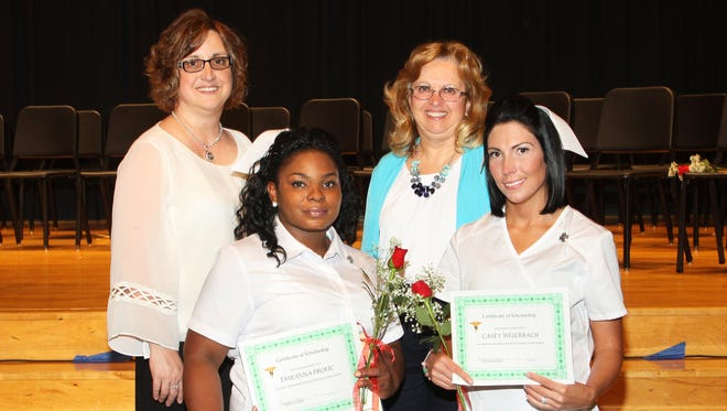 The Woman's Club of Lebanon presented two $750 scholarships to students from the 96th Practical Nursing Program of Lebanon County Career and Technology Center. Back row, left to right: Andrea Frantz, RN, director, Practical Nursing Program, Elizabeth Wentling, President, Woman's Club of Lebanon.  Bottom row left to right: Taseana Profic and Casey Weierbach.