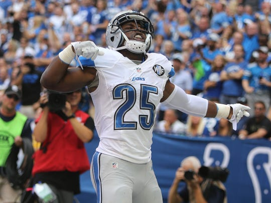 Lions running back Theo Riddick celebrates his touchdown