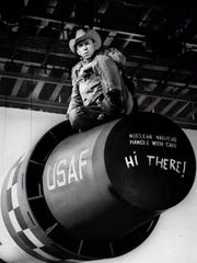 """Actor Slim Pickens, portraying """"Maj. T. J. 'King' Kong,"""" sits atop a nuclear weapon prop during production of the 1964 movie 'Dr. Strangelove.'"""
