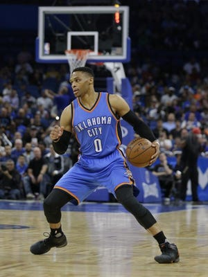 Oklahoma City Thunder's Russell Westbrook moves the ball against the Orlando Magic during the first half of an NBA basketball game, Wednesday, March 29, 2017, in Orlando, Fla.