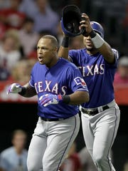 Texas Rangers' Adrian Beltre, left, celebrates his three-run home run with Elvis Andrus during the third inning of a baseball game against the Los Angeles Angels in Anaheim, Calif., Monday, Aug. 21, 2017.