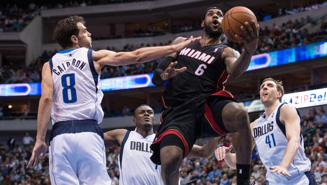 Miami Heat small forward LeBron James (6) attempts a layup during the second half at the American Airlines Center. James lead his team with 42 points, and the Heat defeated the Mavericks  117-106.
