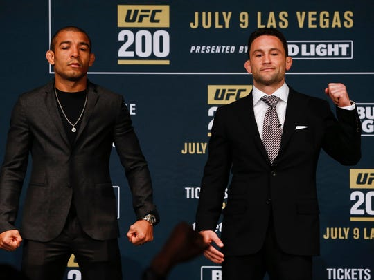 Jose Aldo (L) and Frankie Edgar pose after squaring off during a media availability for UFC 200 at Madison Square Garden on April 27, 2016 in New York City. (Photo by Jeff Zelevansky/Getty Images)