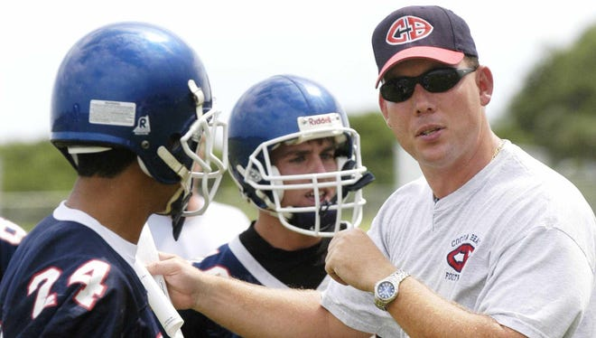 Former Cocoa Beach coach Mark Carstens instructs his players at practice in 2003. Carstens was named head coach of the Satellite High School football program on Wednesday. Photo by Craig Bailey/Florida Today.