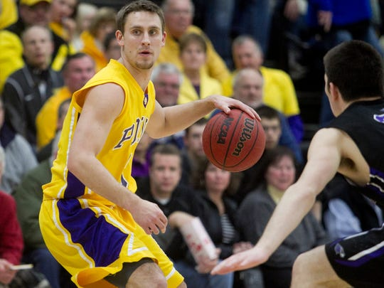 University of Wisconsin-Stevens Point's Austin Ryf looks to pass during the WIAC basketball game against the University of Wisconsin-Whitewater at the Quandt Fieldhouse in Stevens Point, Wednesday, Feb. 11.