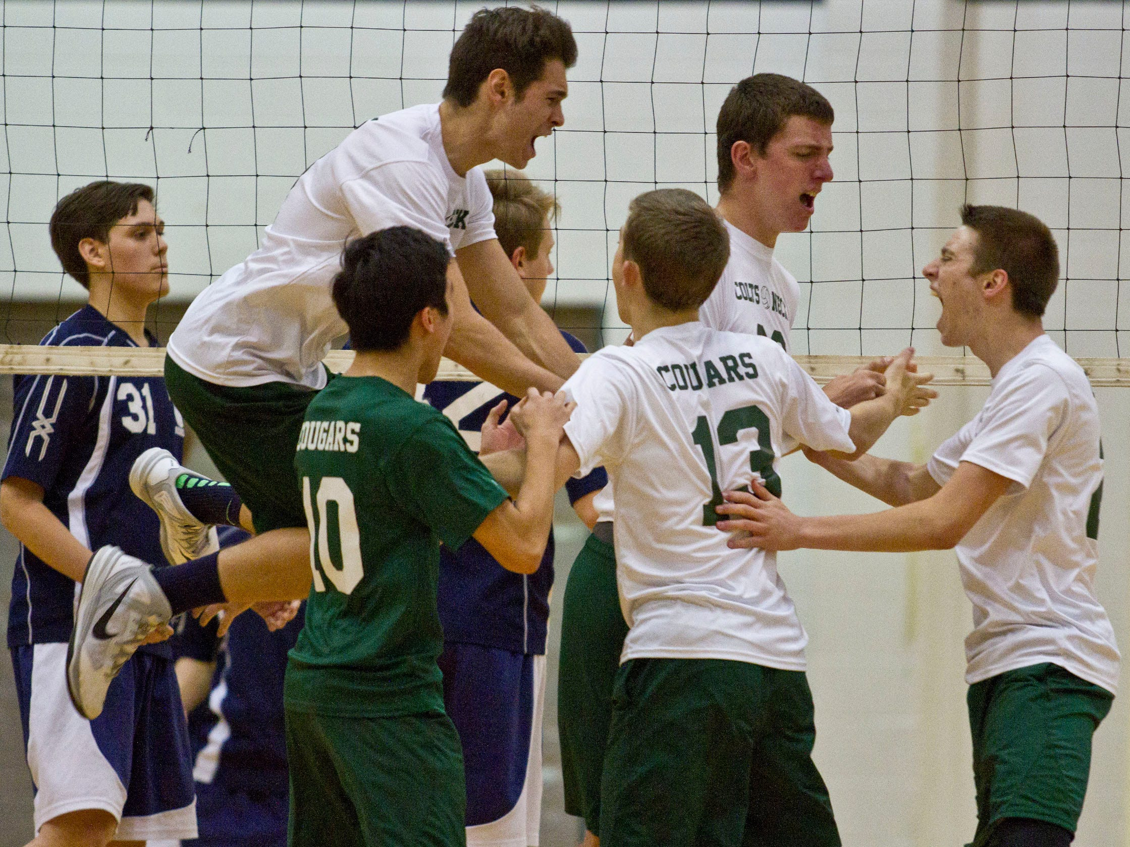 Colts Neck celebrates a point late in the third match. Howell vs Colts Neck volleyball. Colts Neck, NJ Thursday, April 23, 2015 Doug Hood/Staff Photographer @dhoodhood