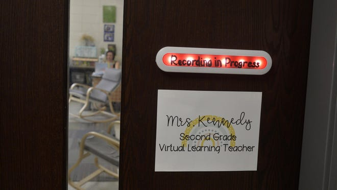Michaela Kennedy communicates with her students via the computer during virtual lessons at Rincon Elementary School.