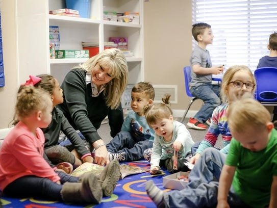Misty Stone, shown with her class at Kids Central Learning