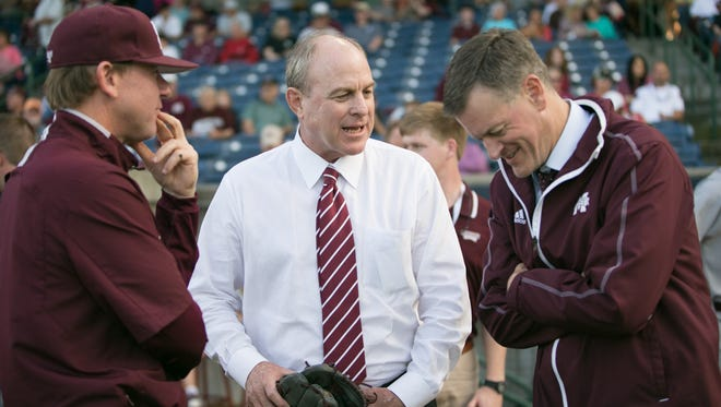 New athletic director John Cohen, left, with basketball coach Ben Howland and the former AD, Scott Stricklin, in 2015.